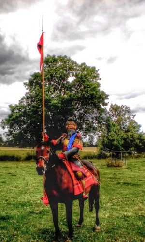 Mounted on one of Dark Horse's mounts again, here the Spahbed is seen in full armour carrying a long lance with a banner. Taken at Spetchley, 2015.